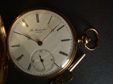 Men's pocket watch with key.
