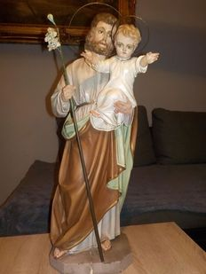 A carved and polychromed wood statue of St. Joseph and Jesus - 19th century