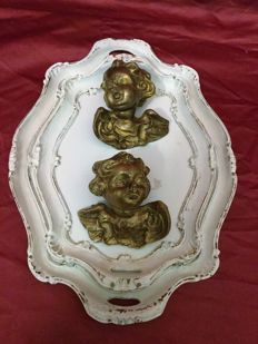 Two lacquered trays of golden cherubs, Italy, 20th century