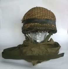 Military stahlhelmet with camouflage net, completely after American US model M1 + interior helmet + face mask-shawl and carry strap - The Netherlands - 20th century