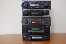 A lot of 5 classic Stereo car radios with cassette from the 1970s and 1980s.