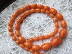Antique amber necklace with a silver clasp