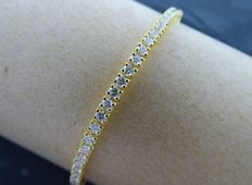 Yellow gold tennis bracelet with 82 brilliant-cut diamonds of 2.50 ct in total, with jewellery certificate, length: 18.00 cm