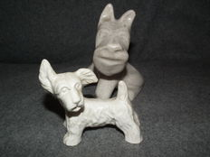 2 pottery terriers-signed