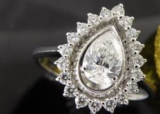 Diamond ring with pear-shaped cut diamond & 19 diamonds, in total ca. 0.85 ct