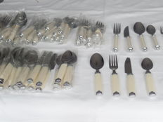 Lot of one 36 -piece and one 44 piece white flatware.