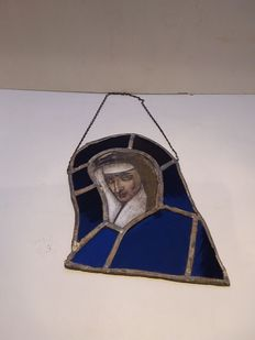 Old stained-glass window with lead.