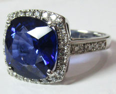 Sapphire Engagement ring with diamond surround