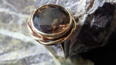 A 14 kt yellow gold ring with a big smoky topaz