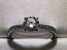 Ring set with 0.95 ct central diamond (G - SI) and lateral diamonds (G - SI) totalling 0.10 ct