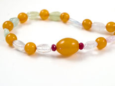 Beryl necklace with amber and rubies with 18 kt white gold clasp