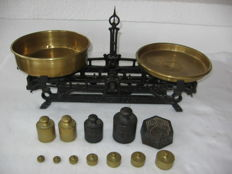 Ancient kitchen scale with attached weights