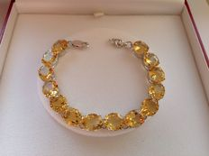 Sterling silver bracelet (925) with 14 fine oval facetted transparent citrines of approx. 11.5 x 9.5mm, approx. 53ct in total
