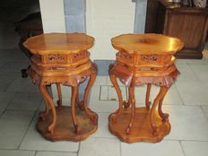 Two hand carved tables.