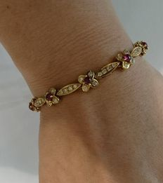 Unique handmade 18 kt yellow gold bracelet set with 1.60 ct natural round brilliant cut diamonds and ruby pigeon blood, cabochon cut ruby