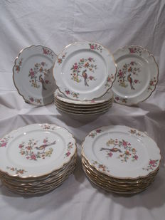 22 plates in porcelain of Limoge, birds and flowers, gold trimmed.