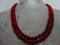 Red Mediterranean faceted long coral necklace to be worn in 2 rows