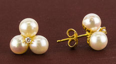 Gold earrings with three cultured Akoya pearls measuring 5.50 mm in diameter (approx.) and set with  cubic zirconias