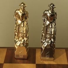 Very fine chess set Don Quixote in gold and silver colours