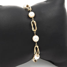 Yellow gold bracelet with round pearls