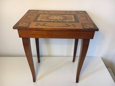 Sewing table with music box