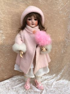 Articulated French girl doll by SFBJ, marked: Unis France