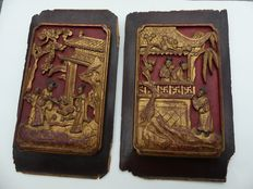 Two antique Chinese red panels, gold plated, varnished – China – late 19th century