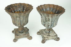 A couple of nicely shaped cast iron garden vases - France - ca. 1920