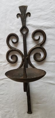 Old metal, wrought iron wall sconce