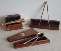 Collection of naval compasses and brass telescope.