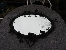 Oval wrought iron mirror with roses