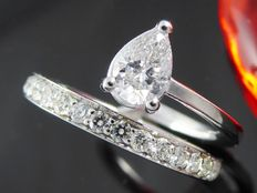 Exclusive white gold ring of 1.05 ct in total, set with pear cut diamond
