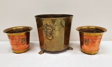 Three copper flower pots with lion heads