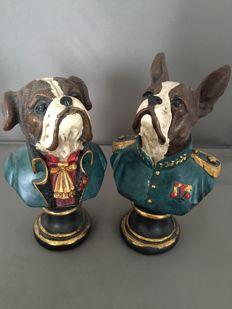 Busts of two dogs in uniform