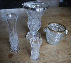Four bohemian style diamond-cut crystal vases