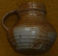 Stoneware jug from Raeren, with handle and rotational grooves