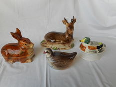 Four lovely faience terrines _ a deer _ a rabbit _ a duck _ a partridge