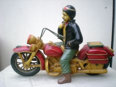Old motorcycle with driver