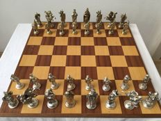 Fine metal chess pieces - silver and gold coloured