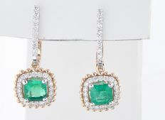 Earrings in 18k bicolour gold set with 2 intense green Columbian emeralds, in total 1.30 ct and 56 brilliant cut diamonds, 0.50 ct in total.