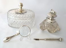 Silver desk accessories, consisting of a ink well, magnifying glass, fountain pen and cover jar