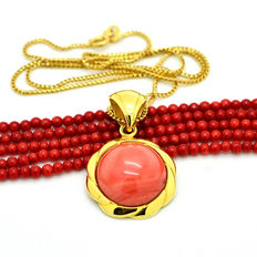 Hand-crafted gold necklace with pendant set with large coral