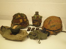 2 helmets, gas mask, epaulettes and a drinking flask with pouch