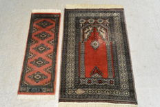 Two beautiful Orient carpets Buchara with signature Soltani & Golestan 96 x 64 cm, 85 x 32 cm. End of the 20th century