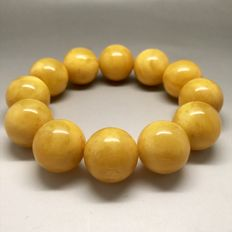 Bracelet of Baltic amber beads 18 mm in diameter, weight 38 grams, bee wax colour