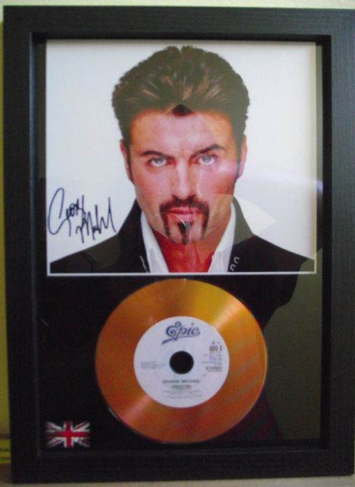 George Michael, 'Freedom!' signed( facsimile )photo and gold disc effect presentation.