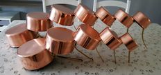 Lot of twelve pans in tinned copper,  red and yellow copper, 7 pans with LARGUS PORTUGAL hallmark