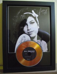 Amy Winehouse, 'Back to Black' signed (facsimile) photo and gold disc effect presentation.