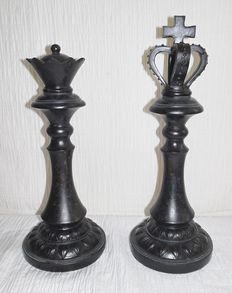 Two large chess pieces - the king and the queen