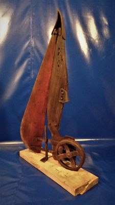 Very old decorative corn cutter on wooden beam